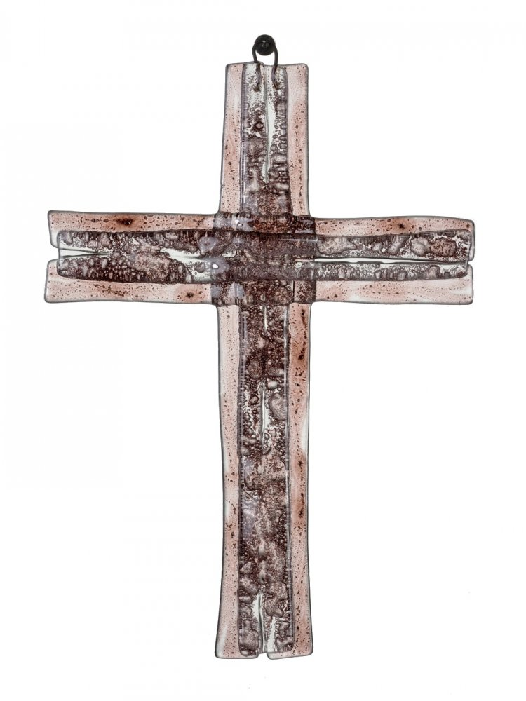 A glass cross on a wall of brown layered small